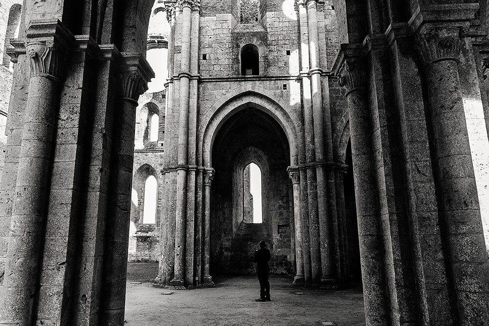 groom waiting for the bride inside san galgano abbey