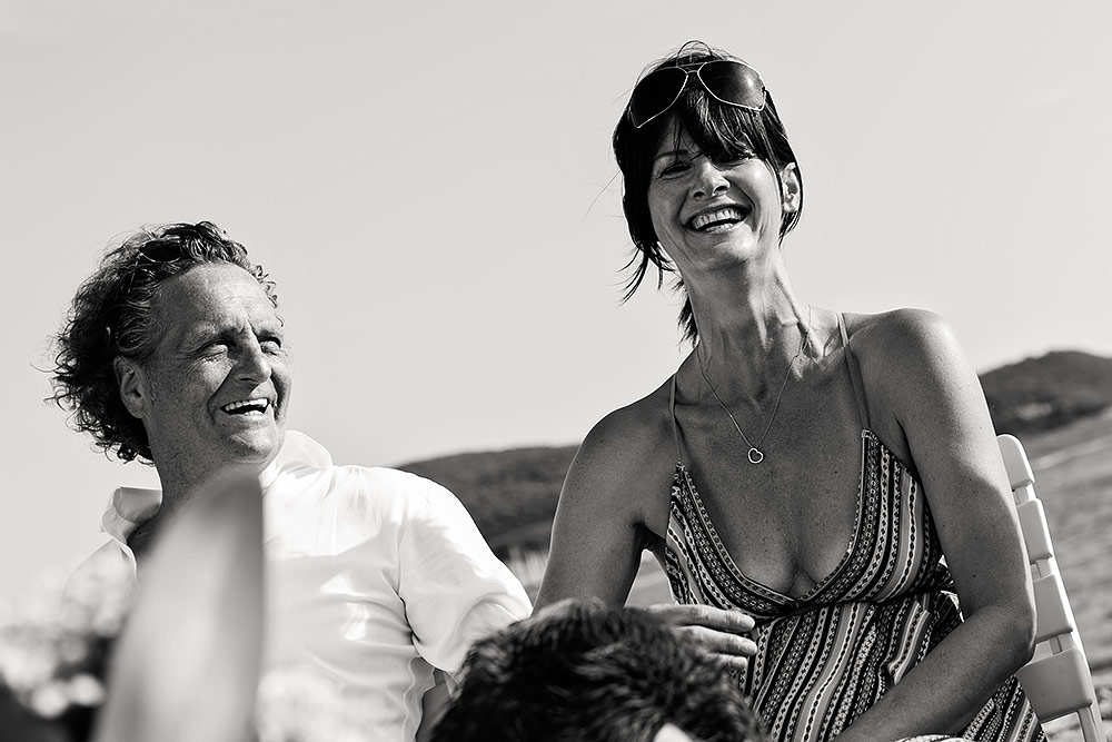 happy bride and groom on tuscany beach wedding