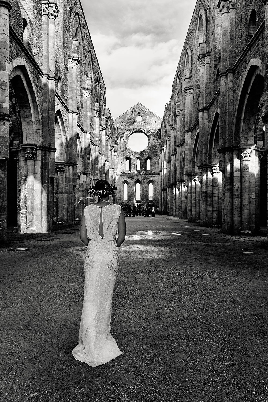 bride walking down the aisle in san galgano