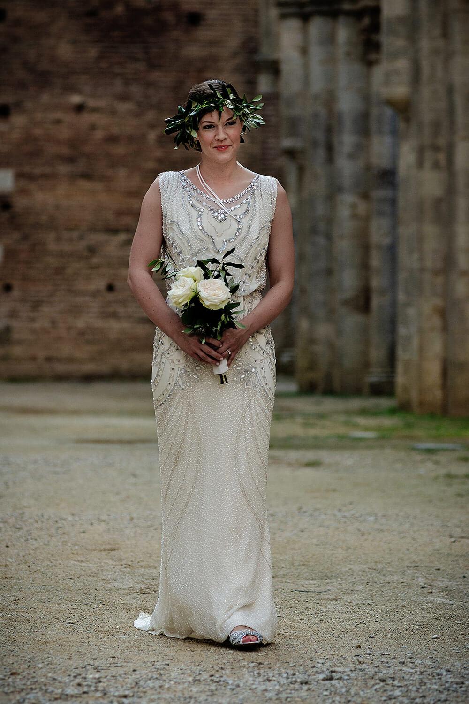 bride walking in san galgano for her wedding