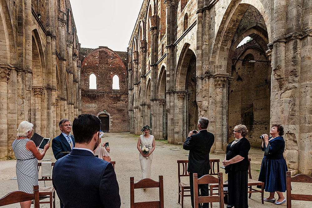 first look bride and groom in san galgano abbey