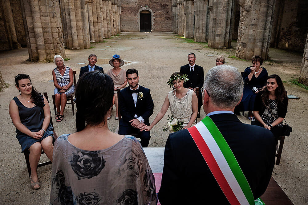 wedding in san galgano abbey, bride and groom with their guests