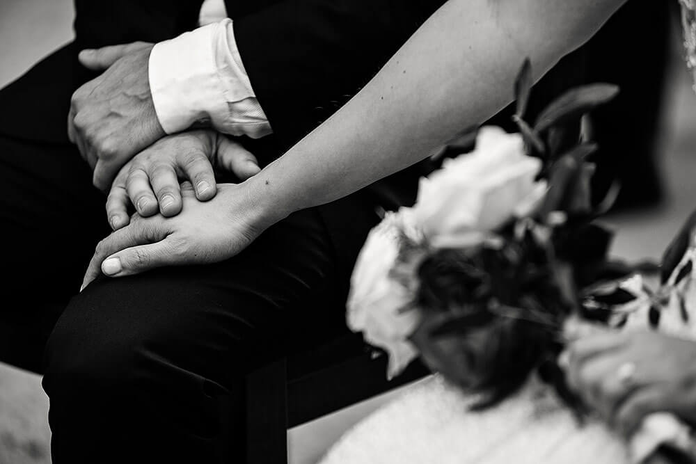 bride and groom hand details of wedding in san galgano abbey in tuscany