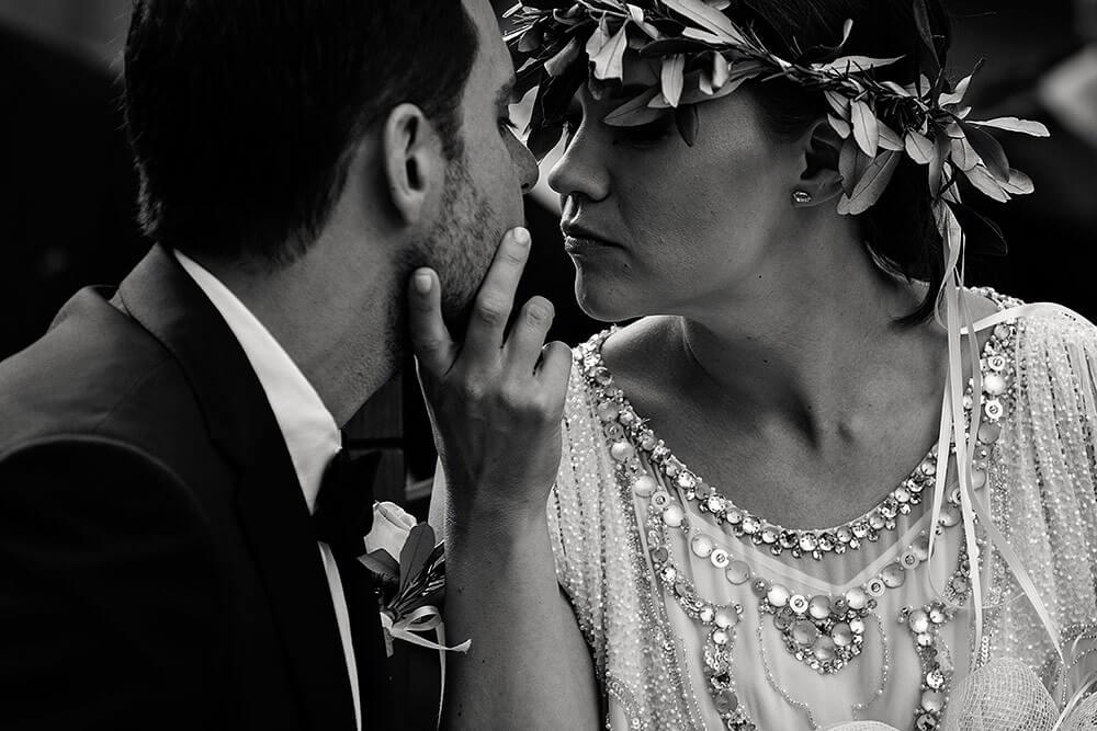 intimate look between bride and groom in san galgano
