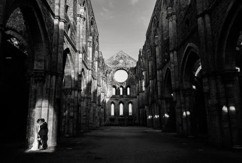 cinematic bride and groom portrait in san galgano abbey