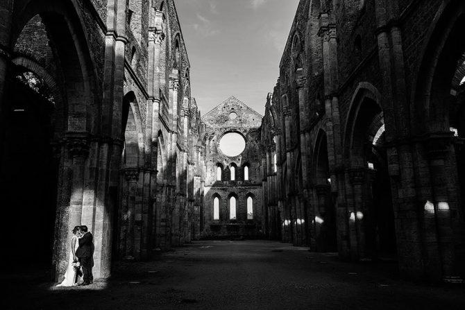 cinematic bride and groom portrait in san galgano abbey