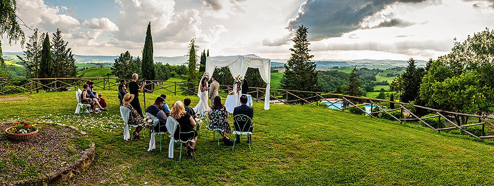 panoramic photo of a wedding ceremony in val d'orcia
