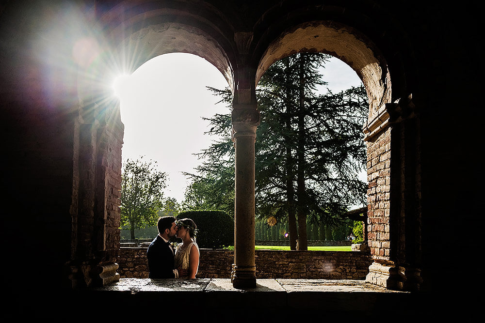 bride and groom kissing in san galgano abbey