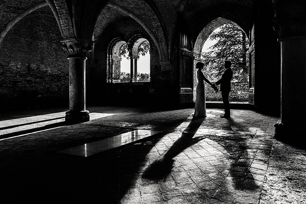 bride and groom black and white portrait in san galgano abbey
