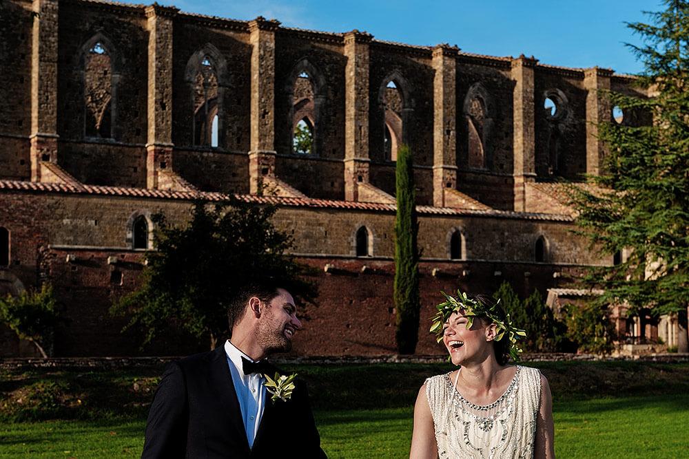 san galgano wedding: bride and groom laughing