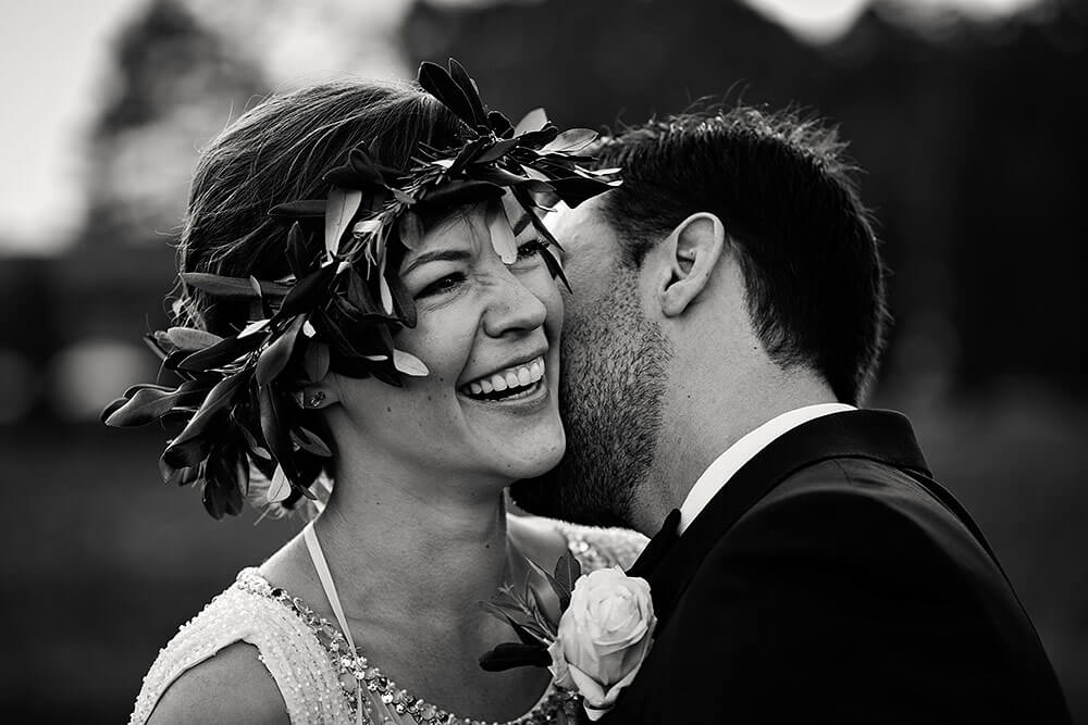 emotional kiss between bride and groom in san galgano