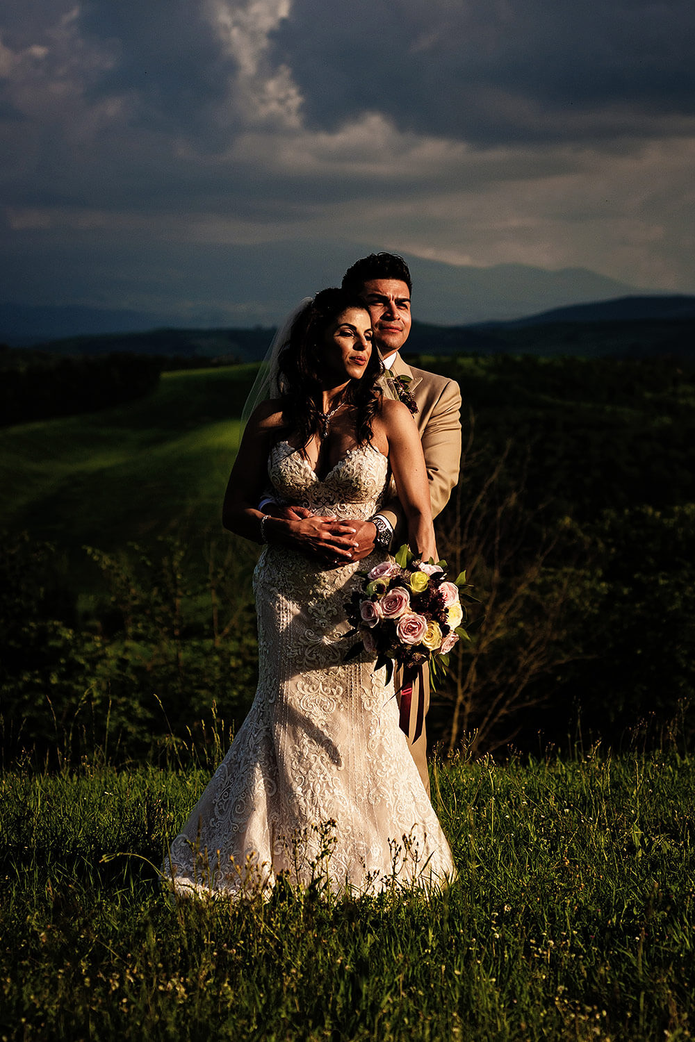 dramatic light: bride and groom portrait in val d'orcia