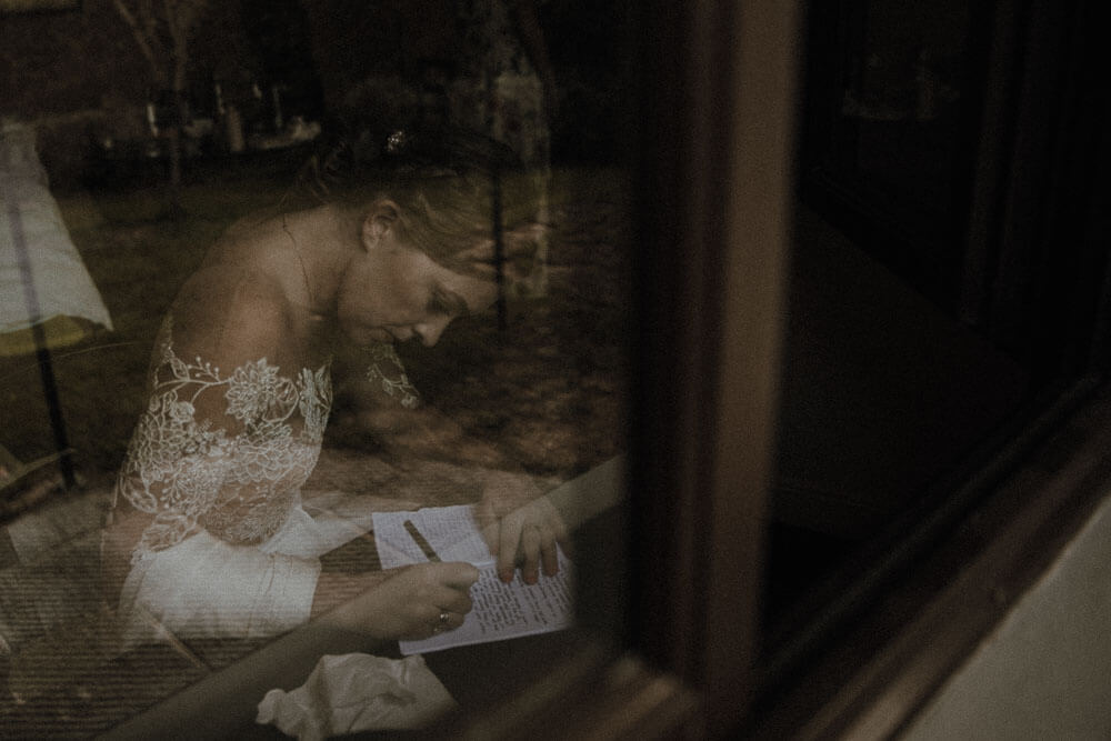 Bride writing wedding vows, destination wedding in Tuscany