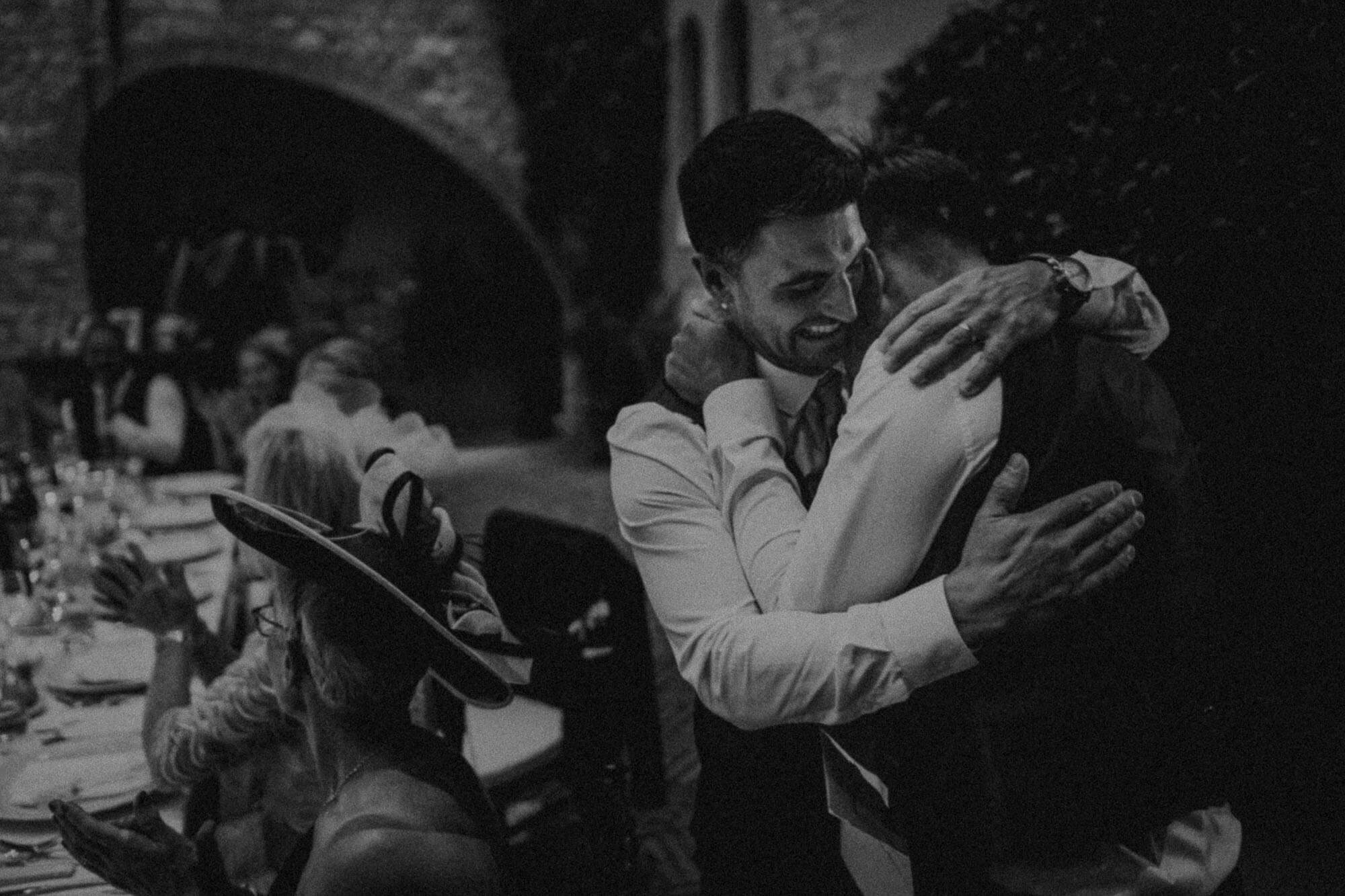 emotional embrace after wedding speeches in tuscany castle