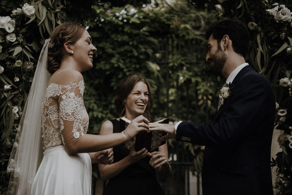 groom and bride exchange rings, destination wedding in florence, tuscany