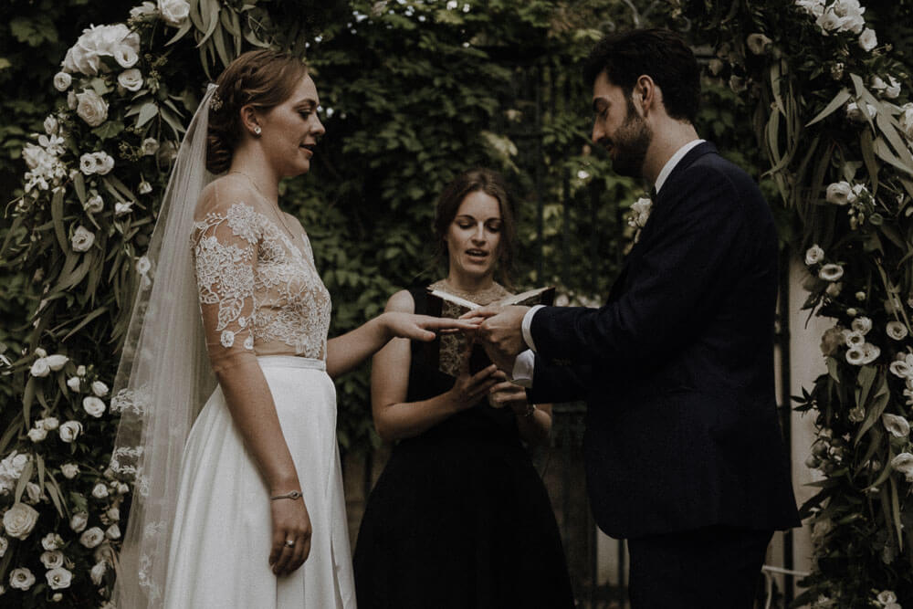 groom and bride exchange rings, destination wedding villa le piazzole florence