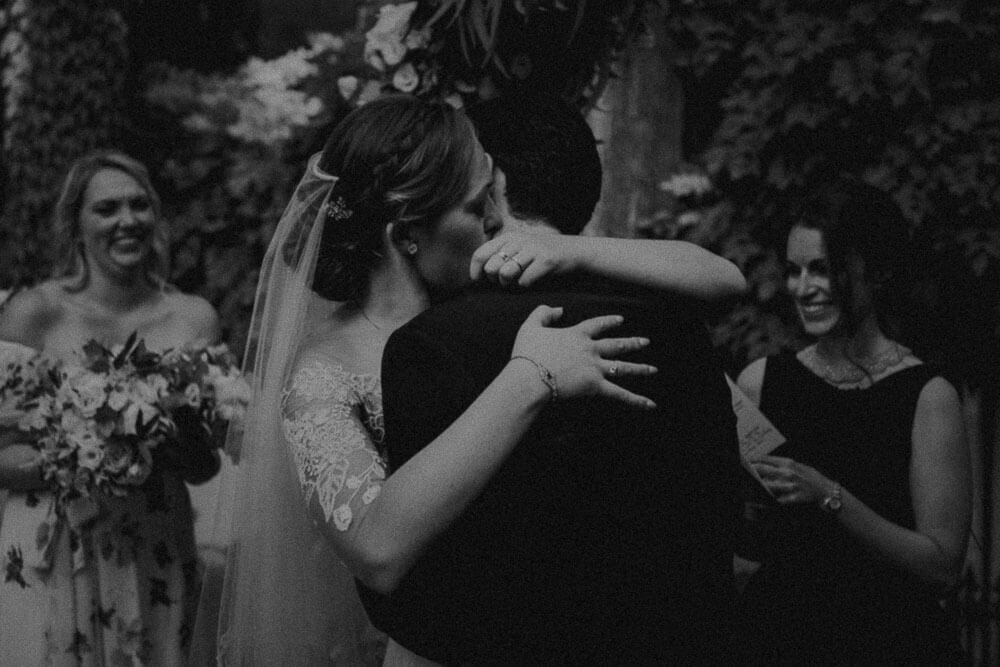 newlyweds embrace after marriage