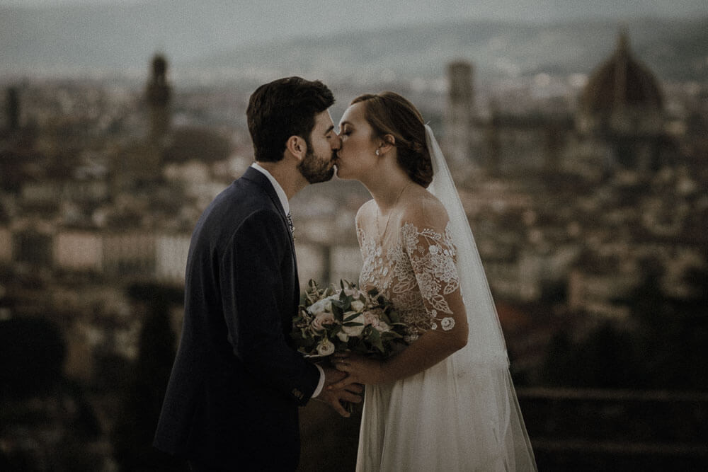 wedding couple portrait from piazzale michelangelo in florence