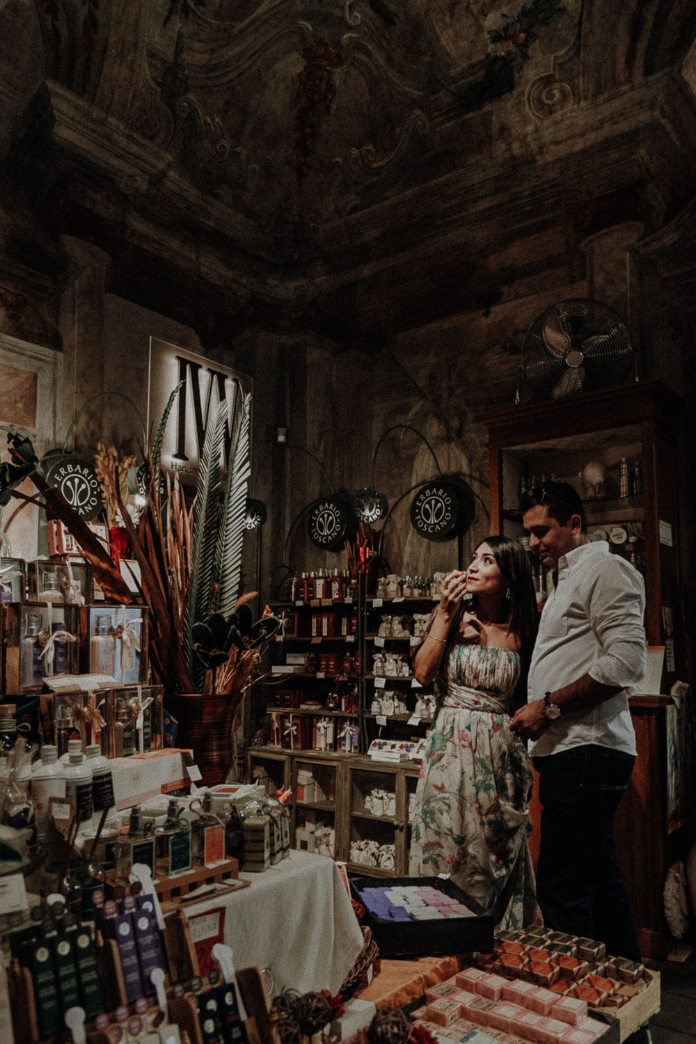 engaged couple in a characteristic Florentine shop
