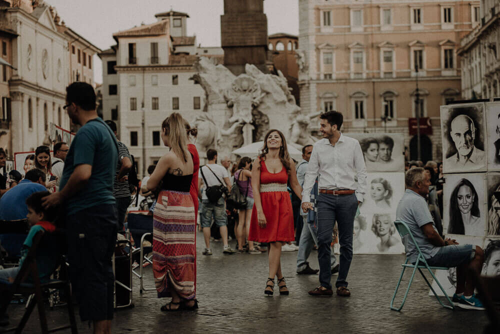 couple in love walking in piazza navona, rome couple photographer