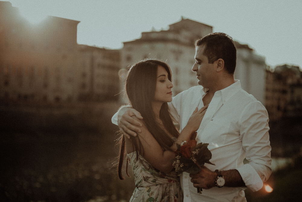 engaged couple photo at sunset on arno river in florence