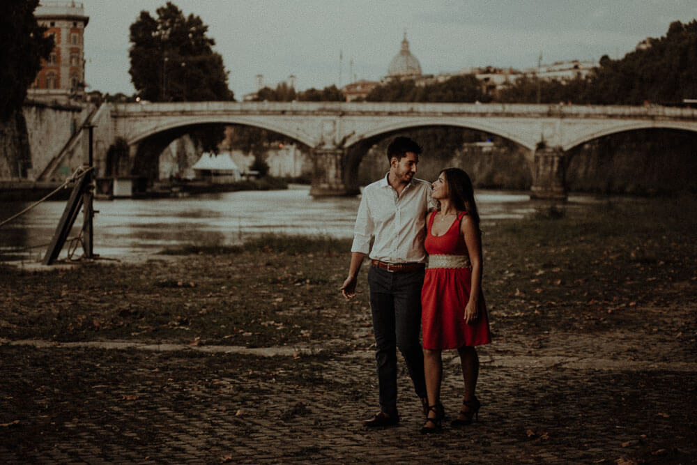sunset walk on tevere river for an engaged couple, engagement photography in rome