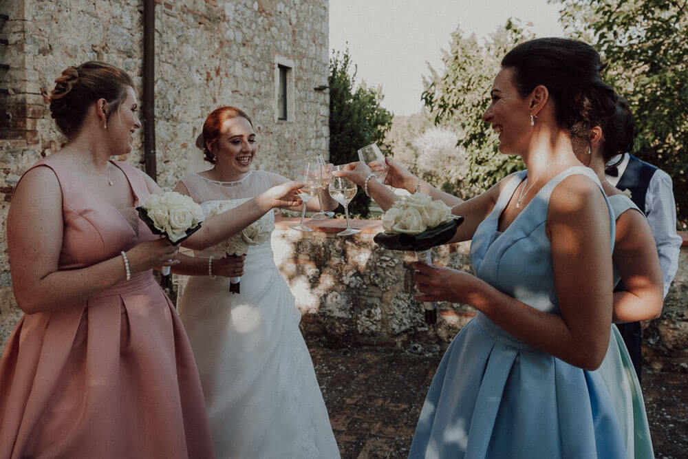 country wedding in tuscany, bride makes a toast with bridesmaids