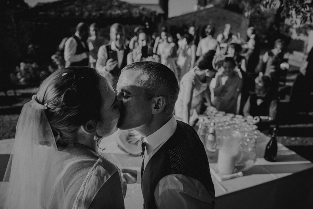 destination irish wedding ceremony in tuscany: bride and groom kiss