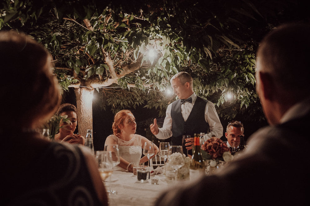 bride and groom speeches during irish wedding dinner in tuscany
