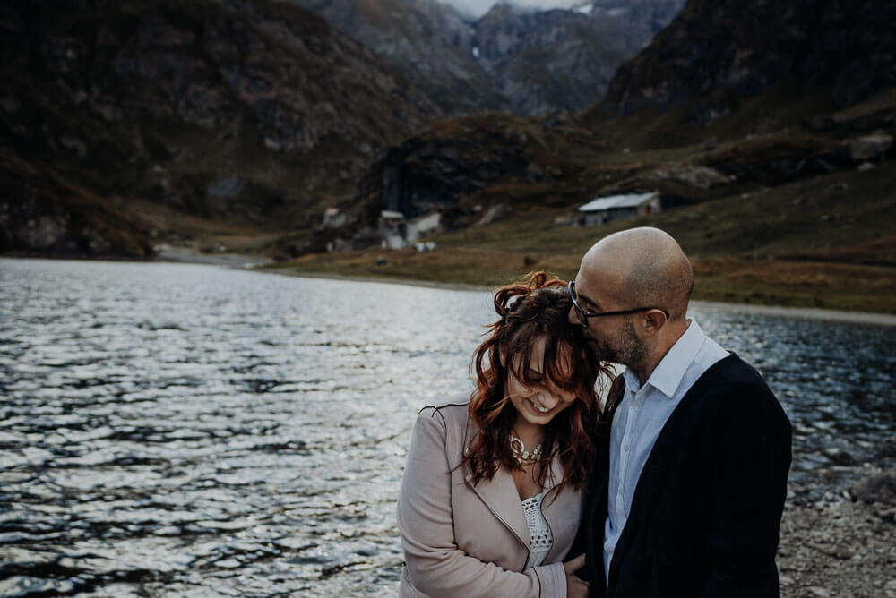 couple cuddling, elopement session on alps