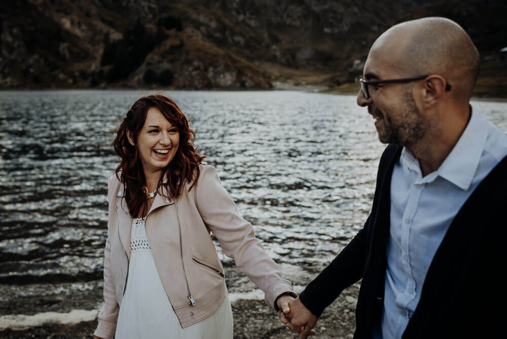 laughing couple, elopement wedding on alps