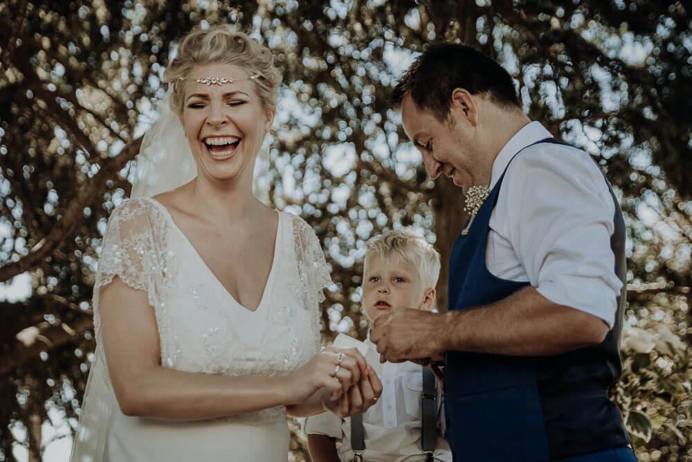 bride and groom ring exchange, langhe piedmont wedding photographer