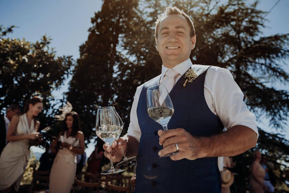 happy groom drinking wine, langhe, piedmont, italy