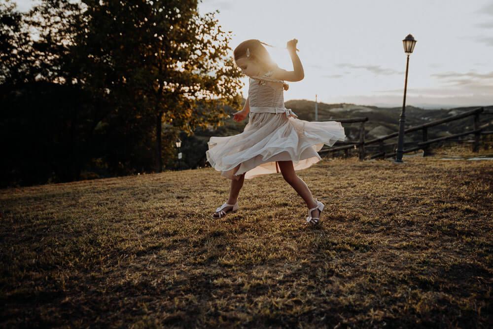 flower girl playing during piedmont wedding