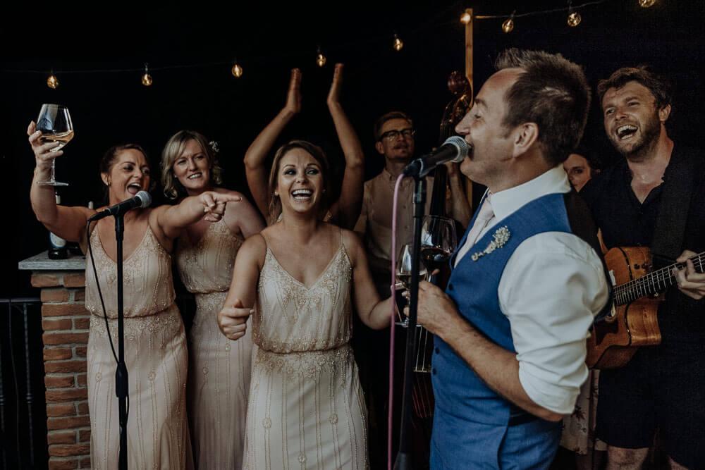 wedding party, groom singing, wedding photographer piedmont