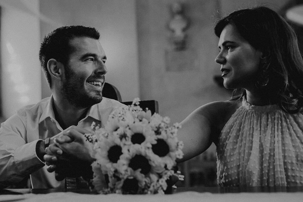 happy wedding couple in cortona town hall
