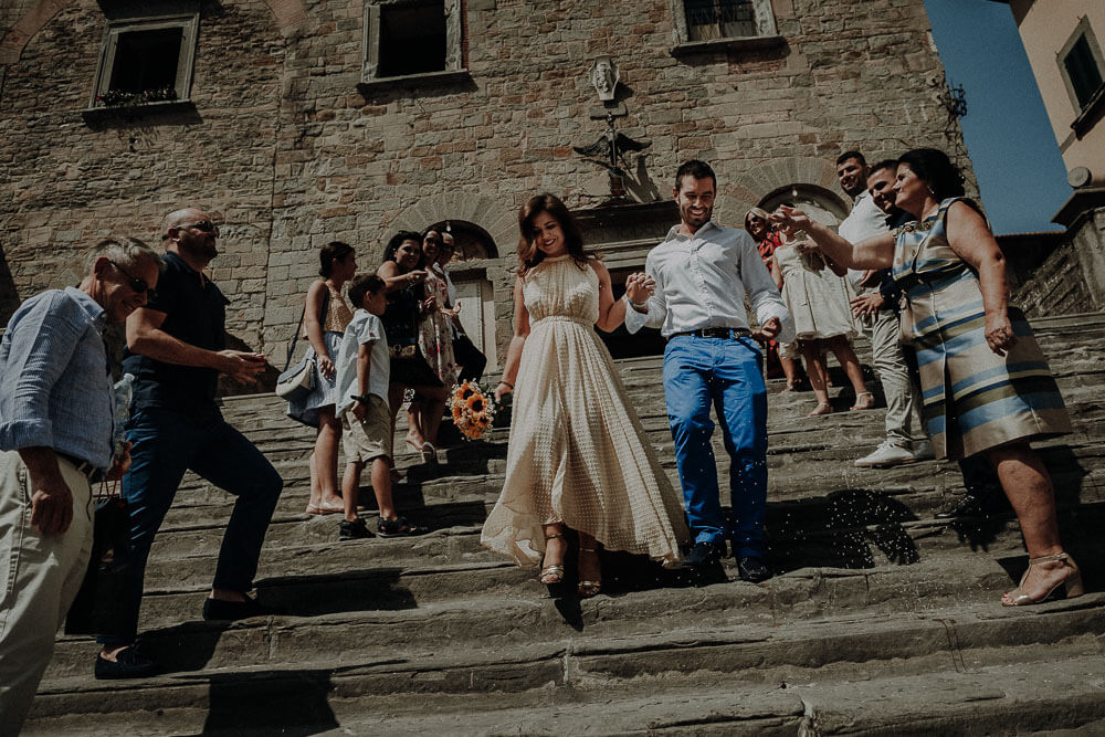 married couple walking down the steps of cortona town hall