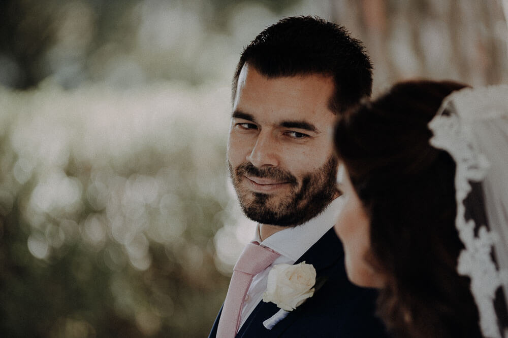 groom in love are looking the bride, tuscany wedding photographer