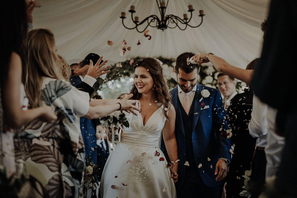 happy married couple are walking down the aisle, tuscany wedding photographer