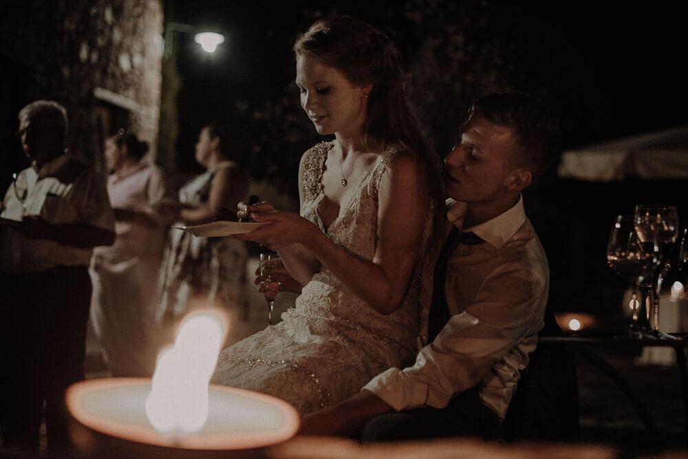Newlyweds eating the wedding cake