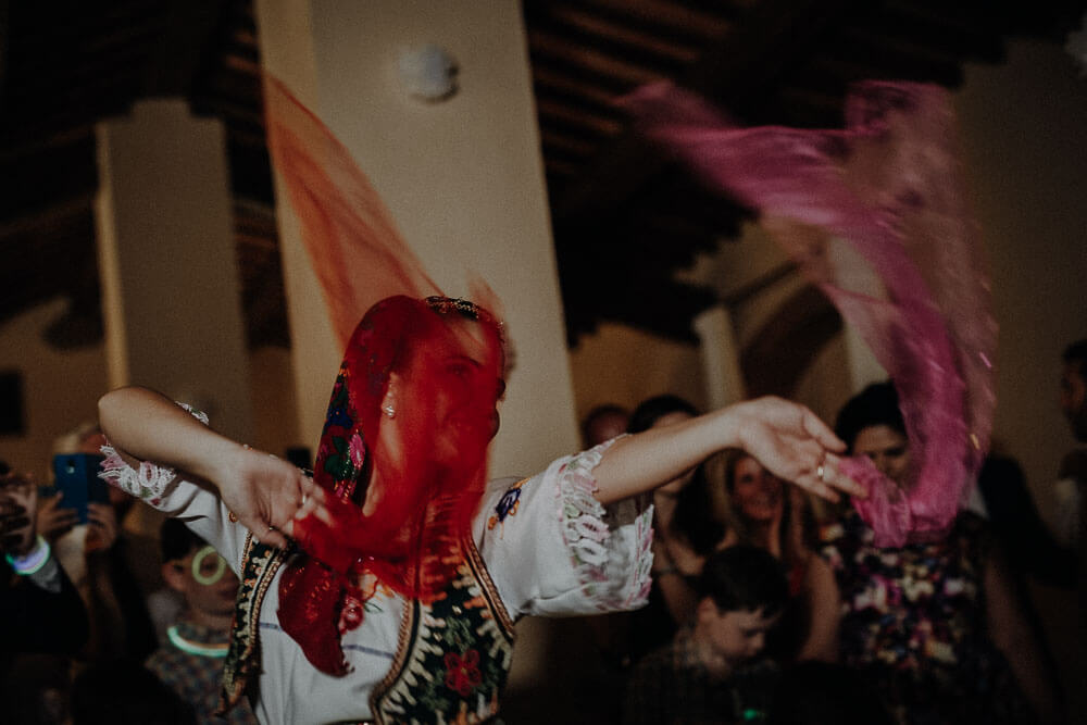 albanian traditional dances during destination wedding party in tuscany
